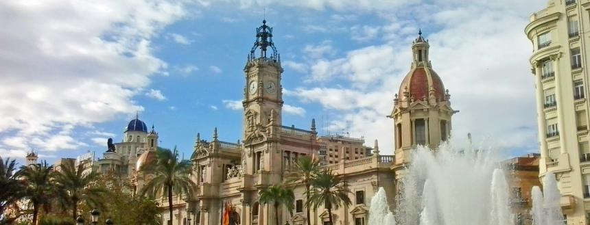 Plaza Ayuntamiento in Valencia with a fountain and clock tower